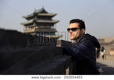 Traveler Man At The Ancient City Of Ping Yao (unesco World Heritage Site). A Famous Historic Site In