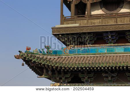 Traditional Chinese Roof. Details Of A Roof At A Tower In The Ancient City Of Ping Yao (unesco World
