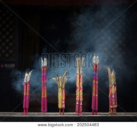 PINGYAO CHINA - NOVEMBER 19 2017: Traditional chinese smoke candles burning at a temple in ancient City of Ping Yao (UNESCO World Heritage site). A famous historic site in Pingyao Shanxi China.