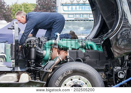 Truck Mechanic Working On Engine