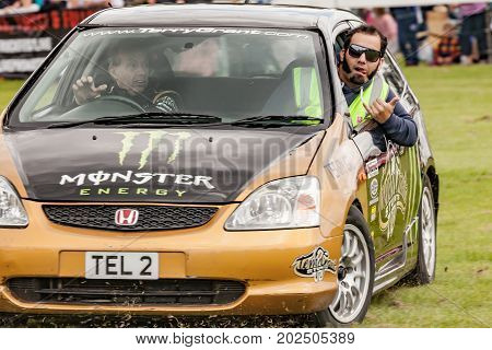 NORFOLK UK - AUGUST 19th 2017: Truckfest Norwich is a transport festival in the UK based around the haulage industry located in Norfolk. Including Monster Truck car crushing. Terry Grant and Jesse Mcclure stunt driving