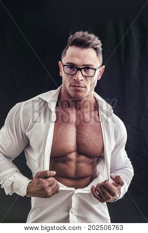 Dorky man with eyeglasses and muscle chest with ripped pecs showing under open shirt