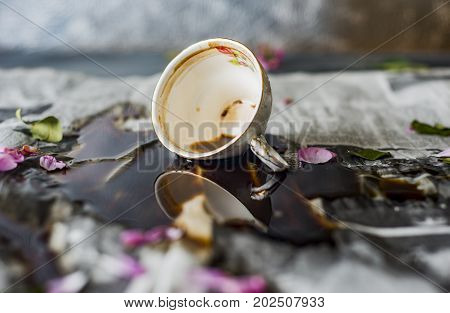 spilled coffee on the table, overturned cup of coffee