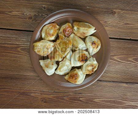 Homemade fish fried dumplings close up https://www.youtube.com/watch?v=hFgwizn1c8E