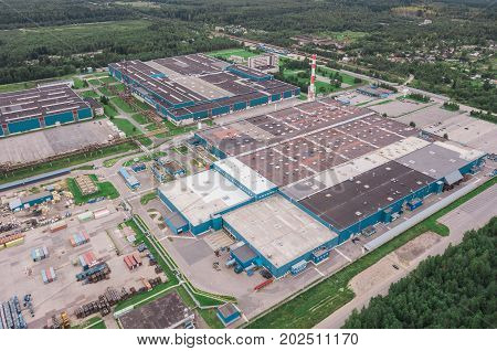Aerial view of huge industrial area near forest