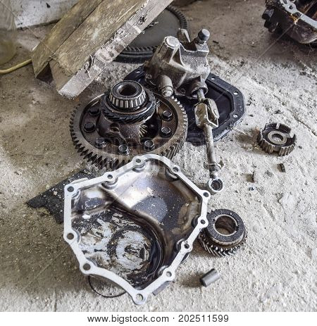 Dismantled Box Car Transmissions. Gear With Bearings And Gearbox Housing. The Gears On The Shaft Of