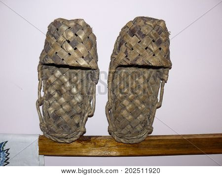 Wicker Shoes Bast Shoes. Bast Shoes On A Stand.