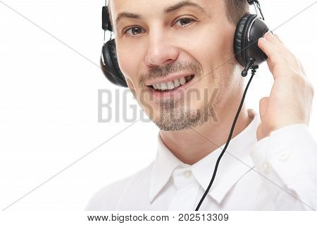 Happy face of call center employee close-up. Man help online