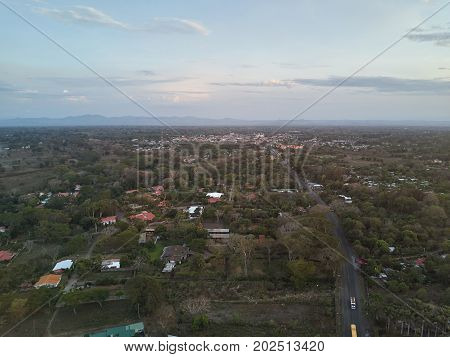 Small city aerial view from drone. Small town in valley background
