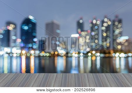 Opening wooden floor Twilight blurred bokeh light office building downtown abstract background