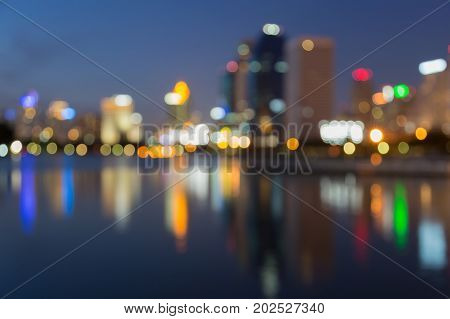Night twilight blurred bokeh office building with reflection abstract background
