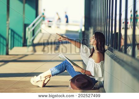 young female tourist in an unfamiliar city. The concept of tourism. blurred background. Copy space for your text