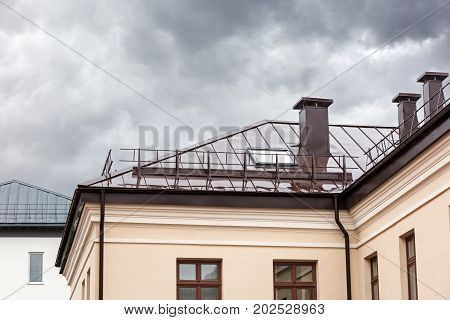 House With Brown Metal Wet Roof During Rain