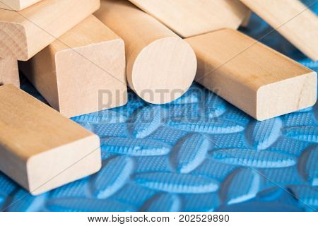 wooden blocks or wooden toys on blue mat