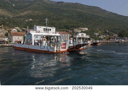 KOTOR BAY, MONTENEGRO - AUGUST 06, 2017:Ferry crossing through Kotor Bay Montenegro.