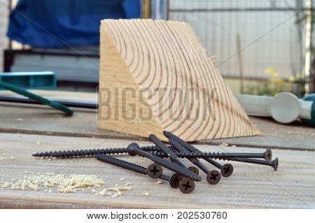 Screws And Wooden Shavings On The Boards