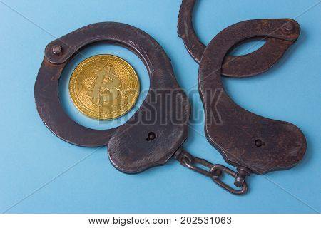 Handcuffs with coin bitcoin and punishment for the crime.