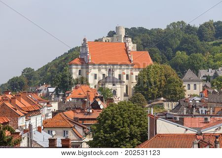 A view of the roofs of the houses and renaissance Parish Church of St. John the Baptist and St. Bartholomew Kazimierz Dolny Poland. It was founded by King Casimir the Great around 1325.