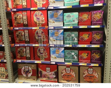 Wuhan, China, 3 September 2017: Numerous Mooncakes boxes on a shelf in a METRO supermarket in China before Moon festival