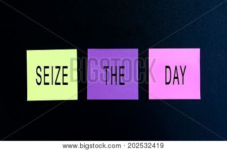 Inspirational Words - Seize The Day On Sticky Note Black Background