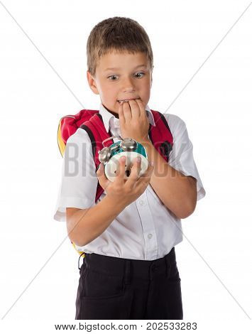 frightened schoolboy with alarm clock in hand, isolated on white