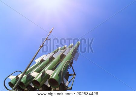 Launcher of the self-propelled system Buk M2 with four missiles on the blue sky background