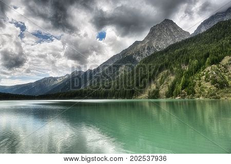 Landscape Of The Lake In The Mountains