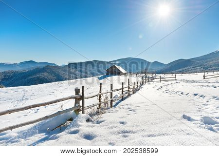 Winter Landscape With A Old Rural House