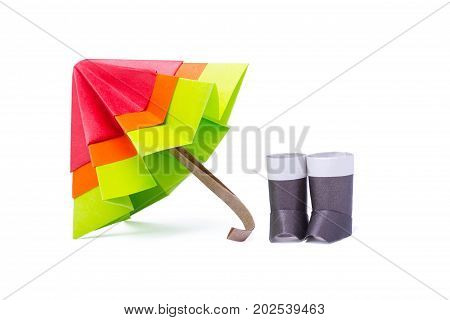 Origami paper umbrella multicolor with gumboots on a white background