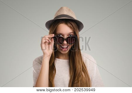 Positive Casual Woman Posing. Emotional Girl Portrait. Young Female With Hat. The Model In Sunglasse