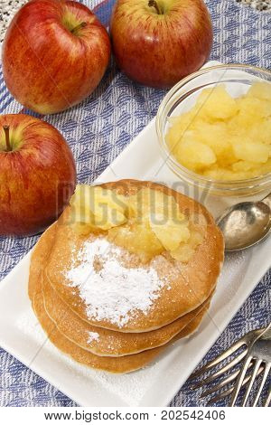 buttermilk pancake with apple compote and powdered sugar