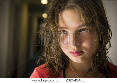 Close-up portrait of a sad girl, 12-13 years, brunette