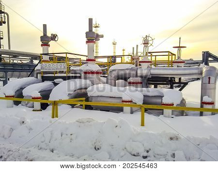 Node Of Valves On Oil Pipelines. Stop Valves In The Snow. Reducers On The Valves.