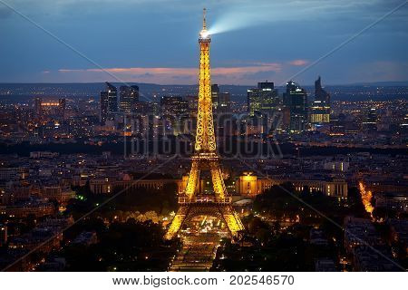 PARIS, FRANCE - AUGUST 20, 2016: Illuminated Eiffel Tower and district la Defence in evening, Paris