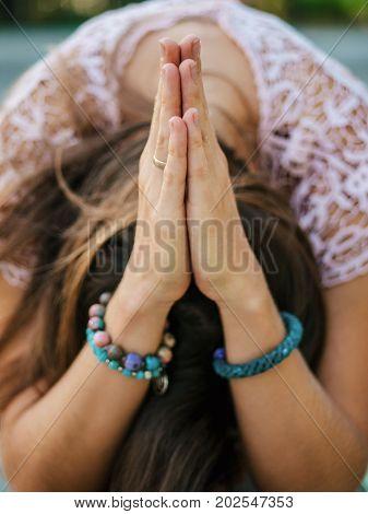 Woman hands together symbolizing prayer and gratitude. Mudra. Yoga concept.
