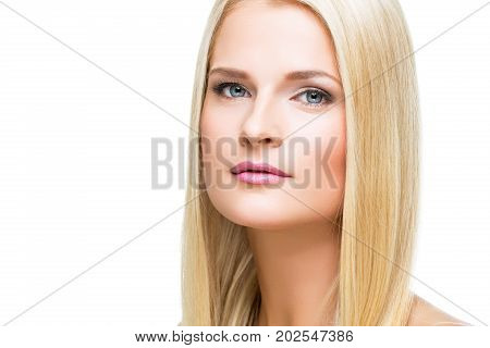 beautiful young woman with blond straing hair and makeup. closeup beauty shot. isolated in white abckground. copy space.