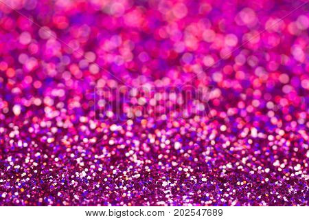 Defocused abstract holidays glitter lights on background.