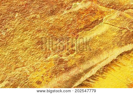 Golden grunge texture of golden nugget surface. Golden background of natural surface