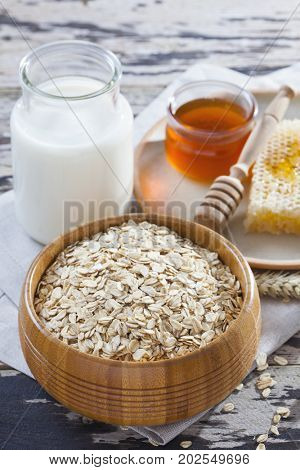 bowl full of oats with milk and honey - healthy breakfast