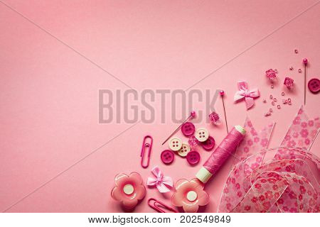 Sewing tool or craft tool on pink background top view or overhead shot with copy space