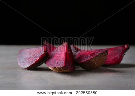 Delicious sliced ripe beet on table