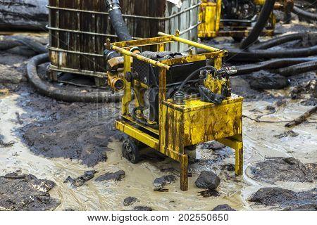 Oil pump evacuate crude oil spilled on the beach in Thailand.