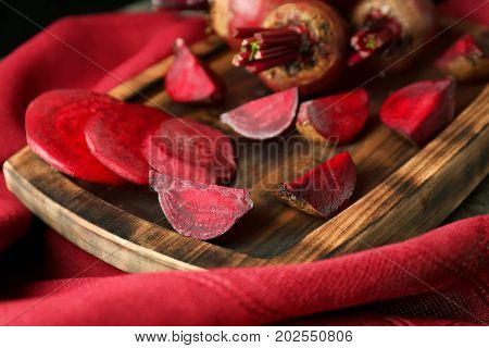 Serving tray with delicious ripe beets on table, closeup