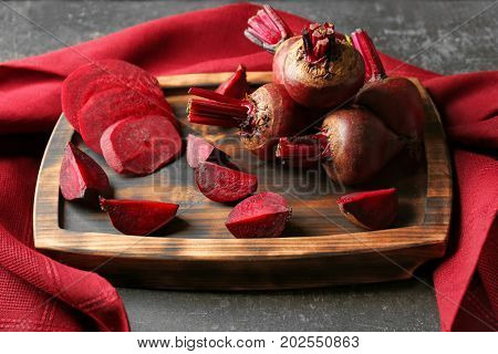 Serving tray with delicious ripe beets on table