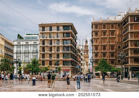Valencia Spain - June 3 2016: Modern buildings on Plaza de la Virgen Cathedral Square in a central location of the city.
