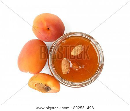 Apricot jam in jar with fresh fruit, isolated on white
