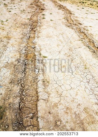 Tire Tracks On Muddy Abandoned Country Road