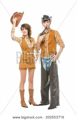 beautiful young woman and man looking like dolls. Cowboy and cowgirl isolated on white background. Copy space.