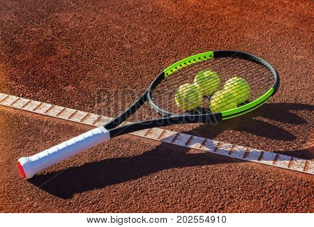 tennis ball and racket on a tennis court