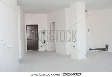 Empty room interior build with plastering wall drywalls stucco metal door wireless.